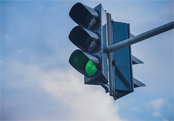a traffic light with the green light on